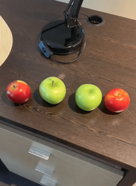 Four apples on top of a cupboard. │Source: tiktok.com/tommymodeactivated