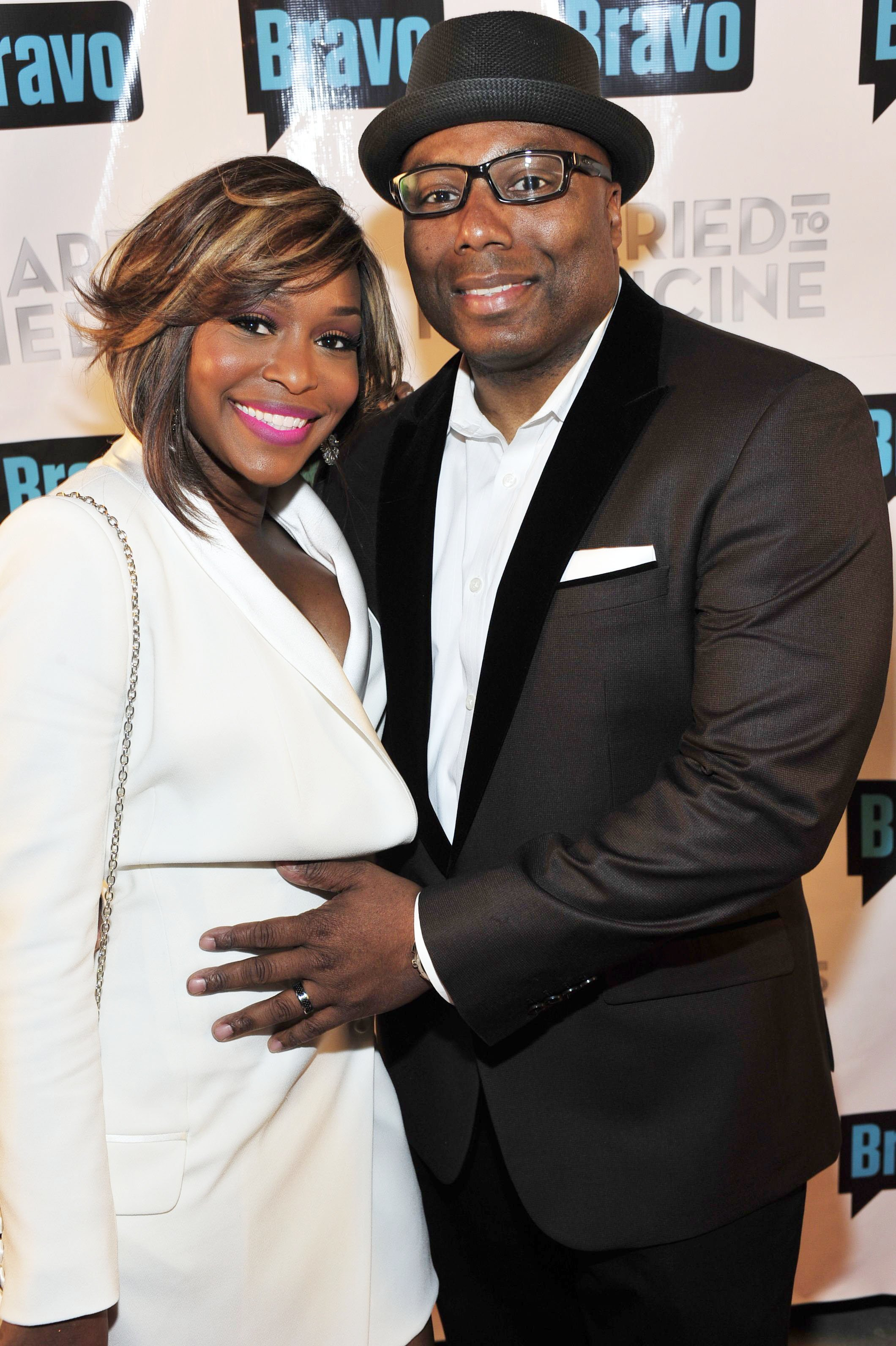 """Quad Webb-Lunceford and Dr.Gregory Lunceford attend the """"Married To Medicine"""" Season 2 Premiere at Shout Lounge on April 3, 2014 