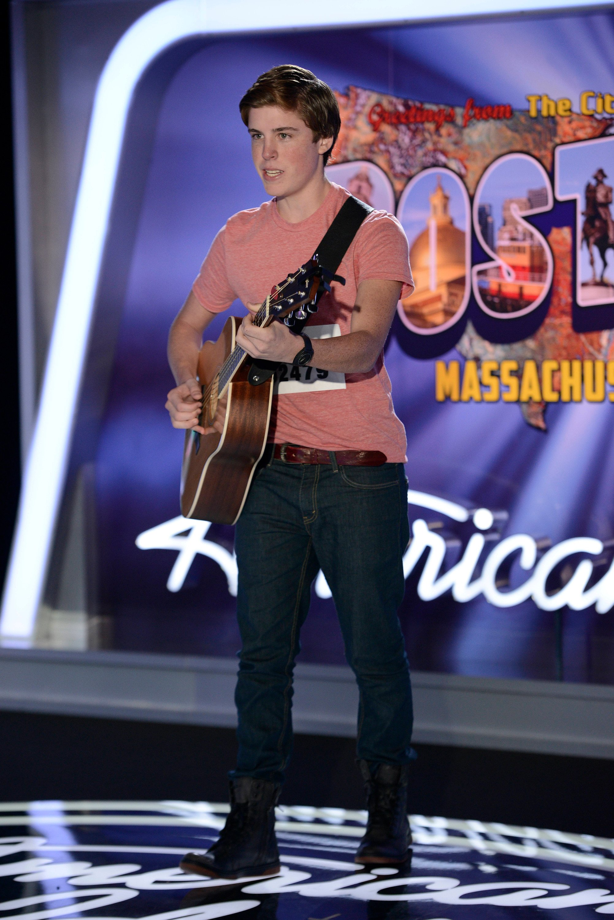 """Contestant Sam Woolf performs in front of the judges  on the 13th season of """"American Idol"""" aired on Jan. 15 2014   Photo by FOX Image Collection via Getty Images"""