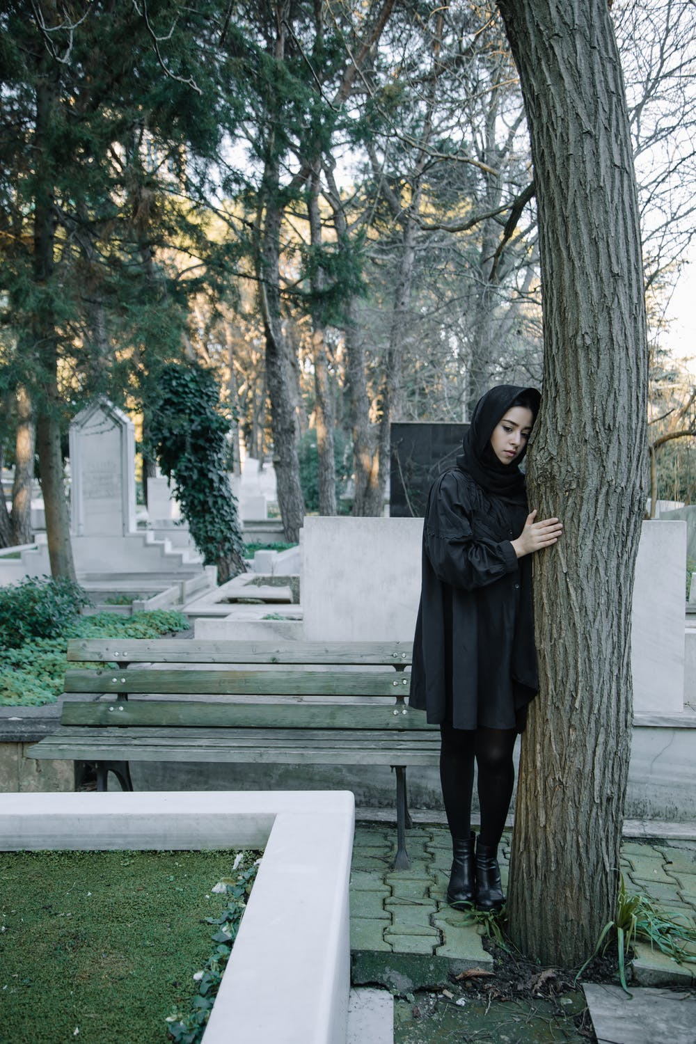 Girl in a cemetery   Source: Pexels