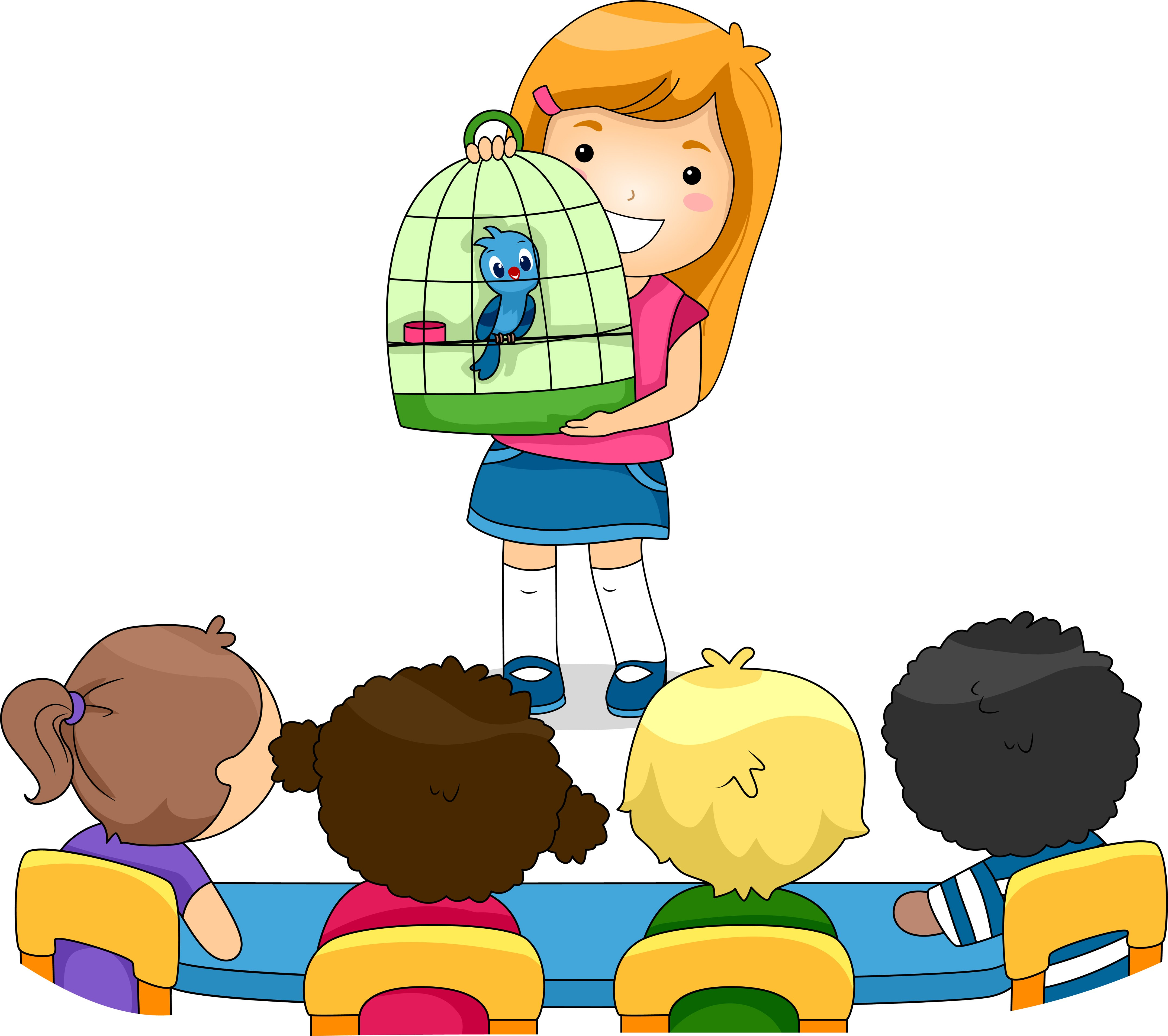 Girl holding bird cage in classroom | Photo: Shutterstock