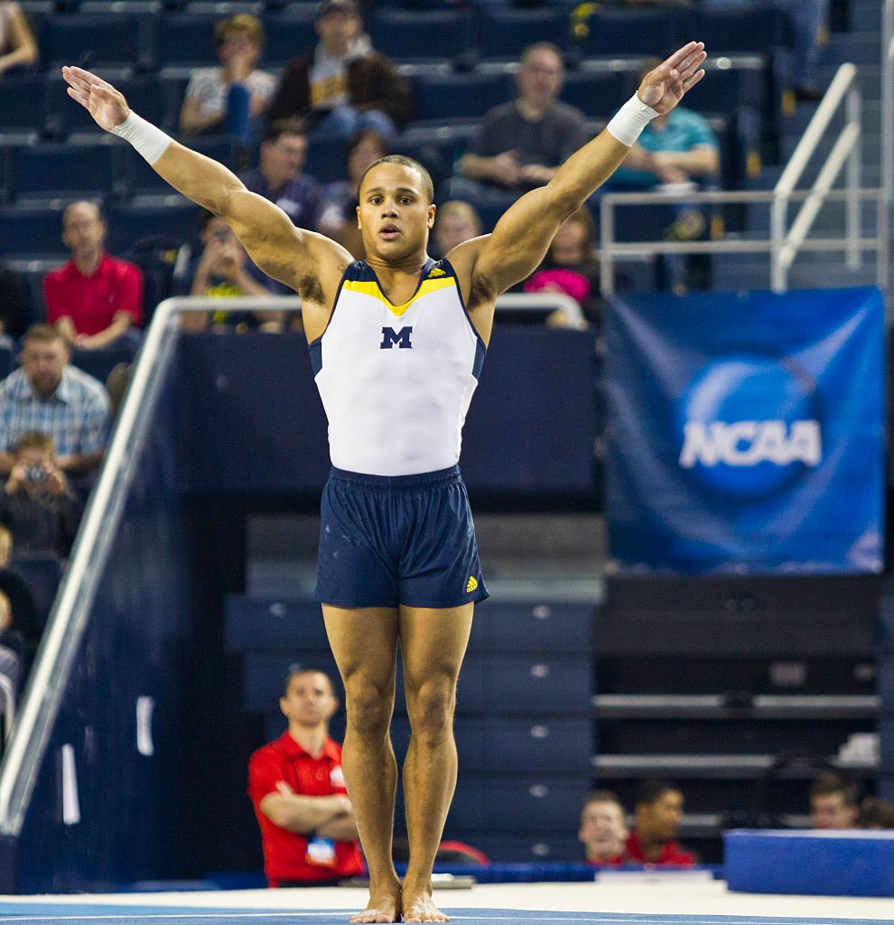 Olympic gymnast Stacey Ervin, Jr. shows off incredible routine during the 2014 national collegiate men's gymnastics championship in Michigan. | Photo: Getty Images