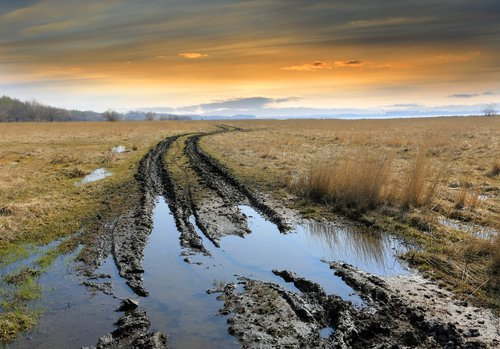 Mud in the road after the rain. | Source: Shutterstock.