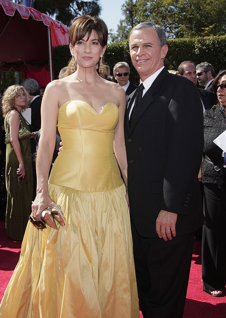 Actor Tony Plana (R) and Ada Maris arrive at the 59th Annual Primetime Emmy Awards at the Shrine Auditorium | Getty Images
