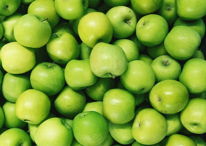 Full frame shot Of Granny Smith Apples for sale In Market   Photo: Getty Images