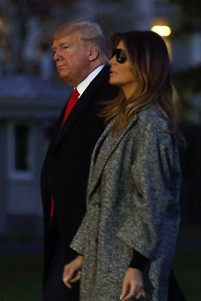 U.S. President Donald Trump and first lady Melania Trump walk on the South Lawn after they returned to the White House | Photo: Getty Images