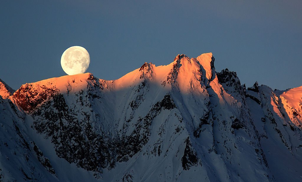 Winter moon overlooking the Austrian Alps, on December 30, 2012, Austria | Source: Getty Images