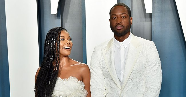 See Look of Surprise on Gabrielle Union & Dwyane Wade's Faces as Their Daughter Digs into Cake