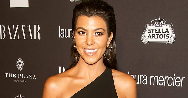 Kourtney Kardashian Gives Glimpse of Lavish Bedroom Posing in Front of a Backlit Vanity Mirror