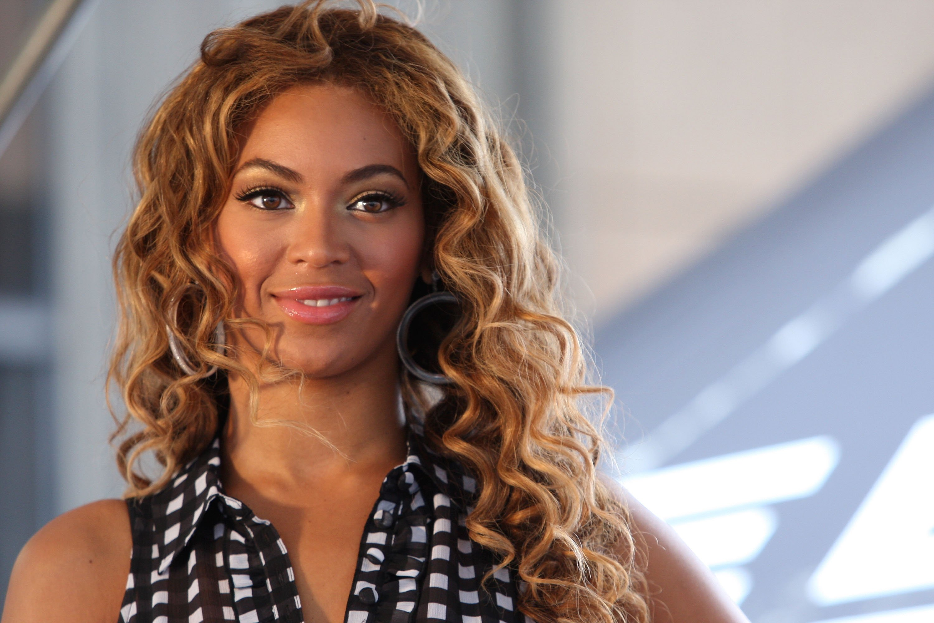 "Beyonce Knowles attends the national ""Show Your Helping Hand"" hunger relief initiative, 2009. 