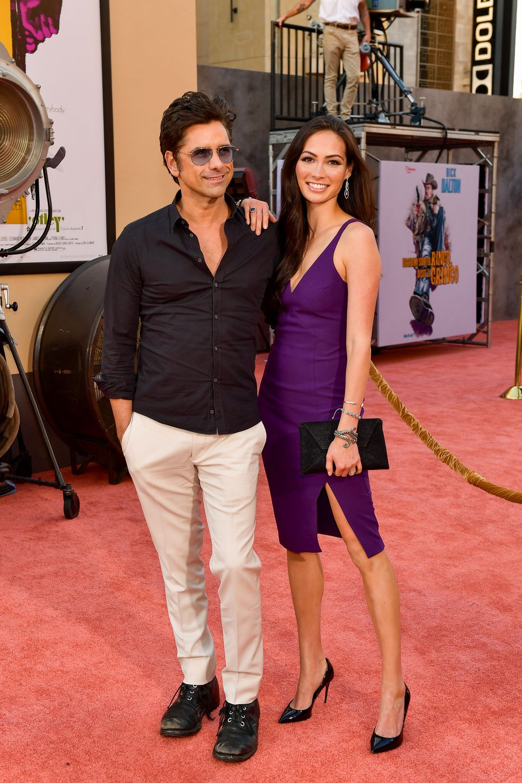 """John Stamos and Caitlin McHugh at the  Los Angeles premiere of """"Once Upon A Time...In Hollywood"""" on July 22, 2019, in Hollywood, California 