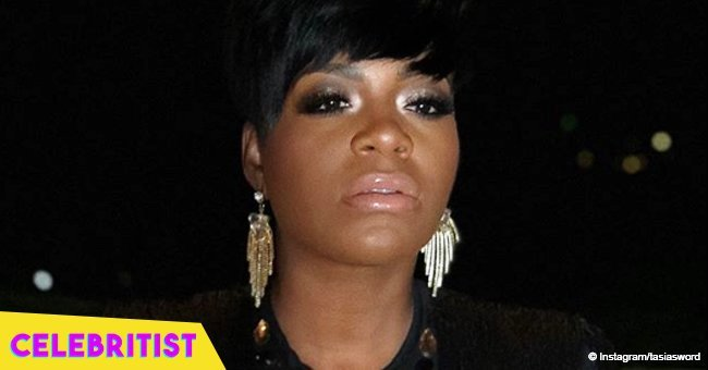 Fantasia stuns in long-sleeved midi dress in photo with her rarely seen father in church