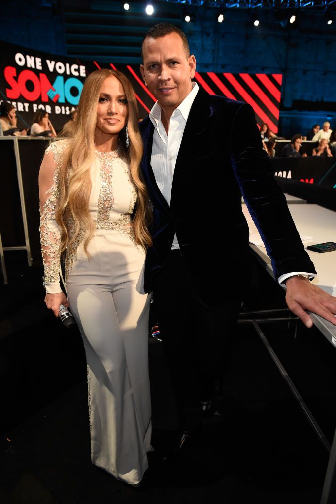 """Jennifer Lopez and Alex Rodriguez pose onstage at """"One Voice: Somos Live! A Concert For Disaster Relief"""" at the Universal Studios Lot on October 14, 2017 