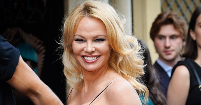 See Pamela Anderson's Flawless Endless Legs and Tiny Waist While Posing in a Mini Trench Coat