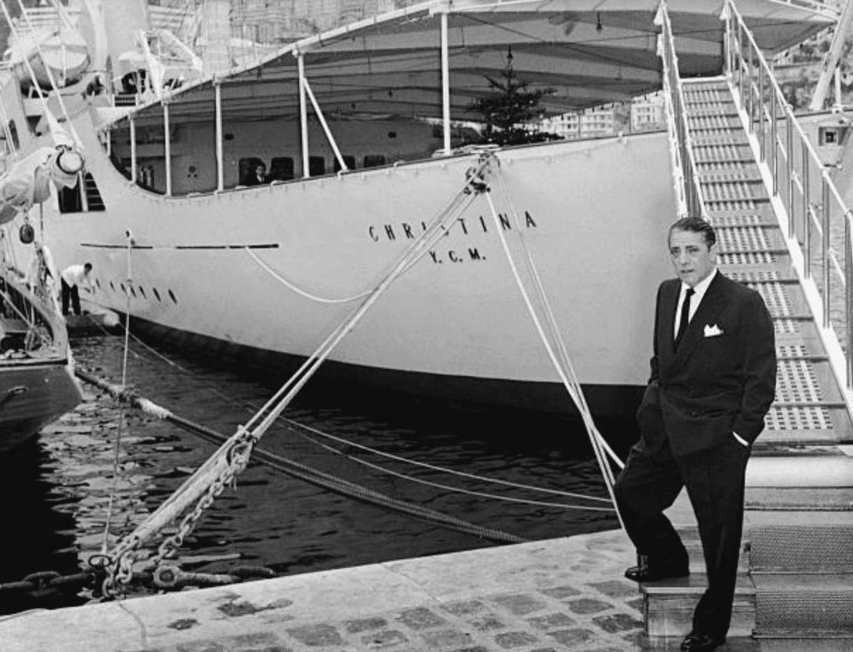 Aristotle Onassis charting the Christina O yacht in1950, Italy | Getty Images