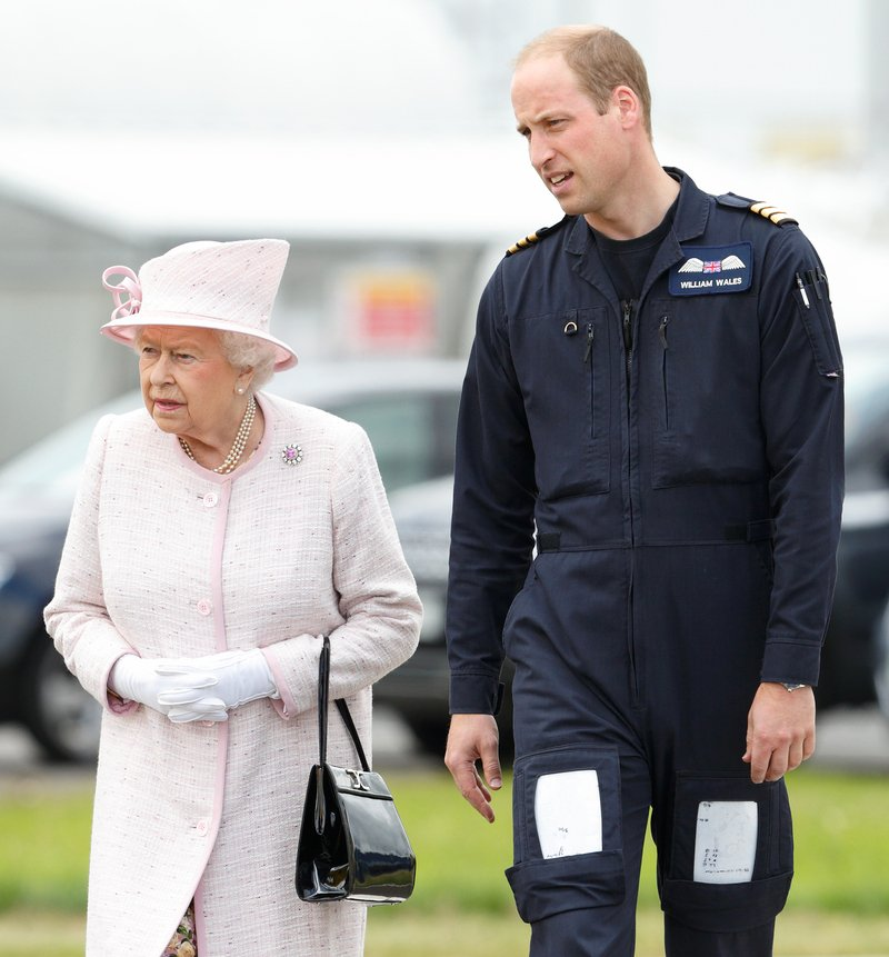 Prince William giving Queen Elizabeth II a tour as she opens the new East Anglian Air Ambulance base at Cambridge Airport in Cambridge, England, in July 2016.   Image: Getty Images.