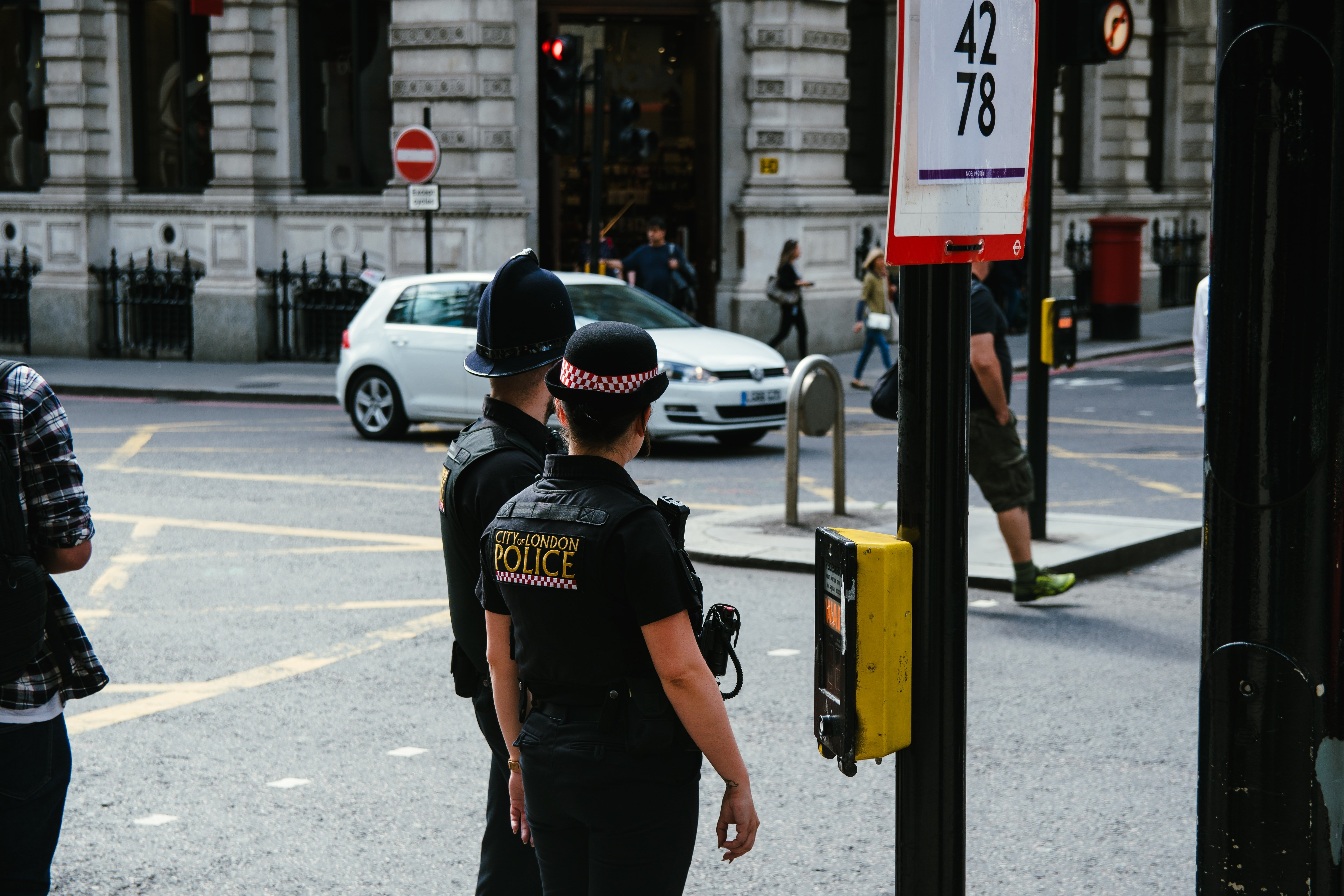 Photo of police officers on the street   Source: Unsplash
