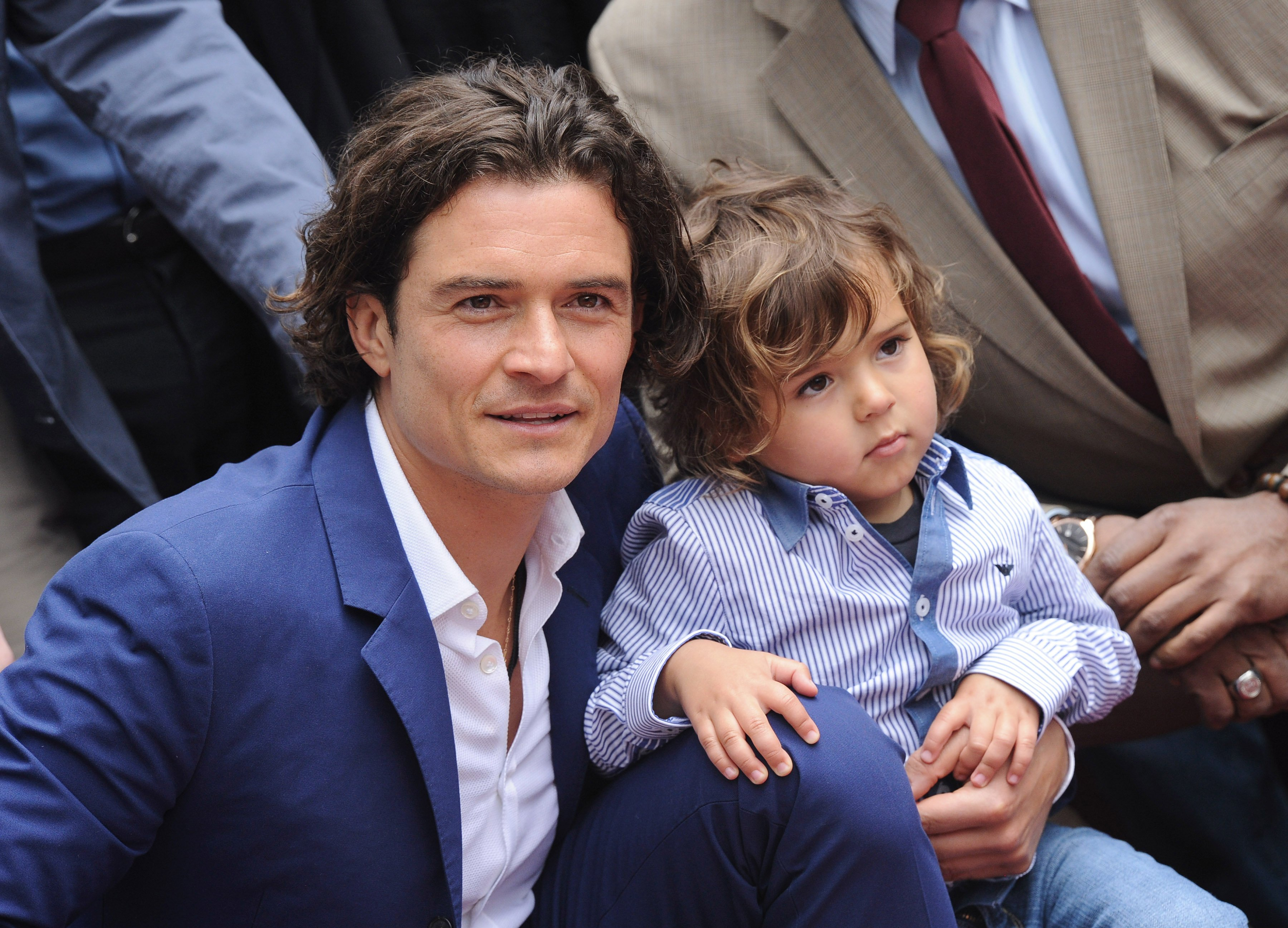 Orlando Bloom and his son Flynn attend Bloom's Hollywood Walk of Fame star honor event in California on April 2, 2014 | Photo: Getty Images