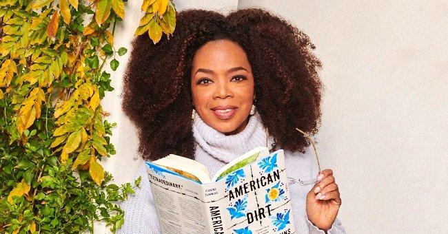 Oprah Winfrey Lets Her Natural Hair Loose as She Poses in Sweater and Jeans in Photo