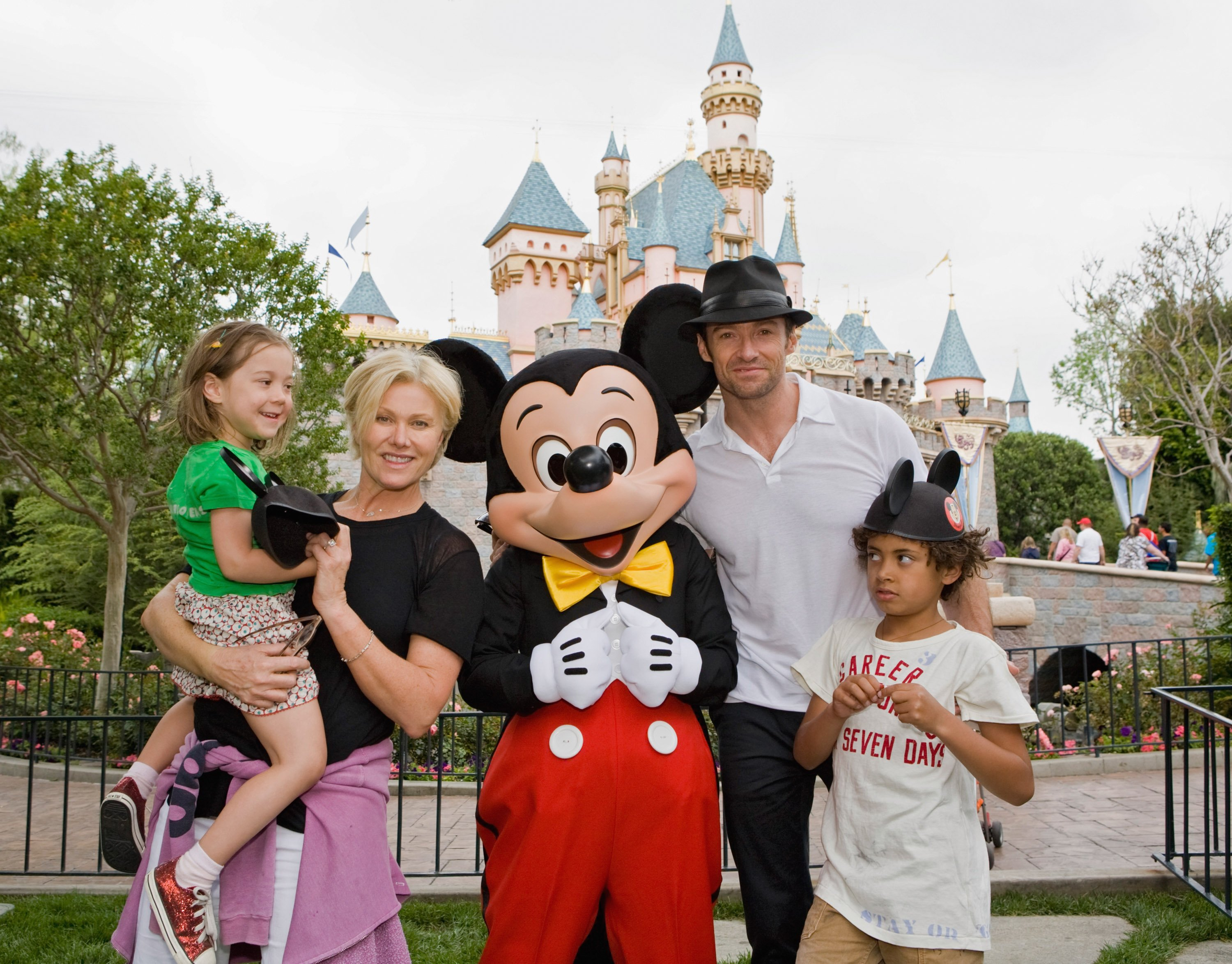 Hugh Jackman, his wife Deborra Lee Furness, and children Oscar Jackman and Ava Jackman pose at Disneyland. | Source: Getty Images