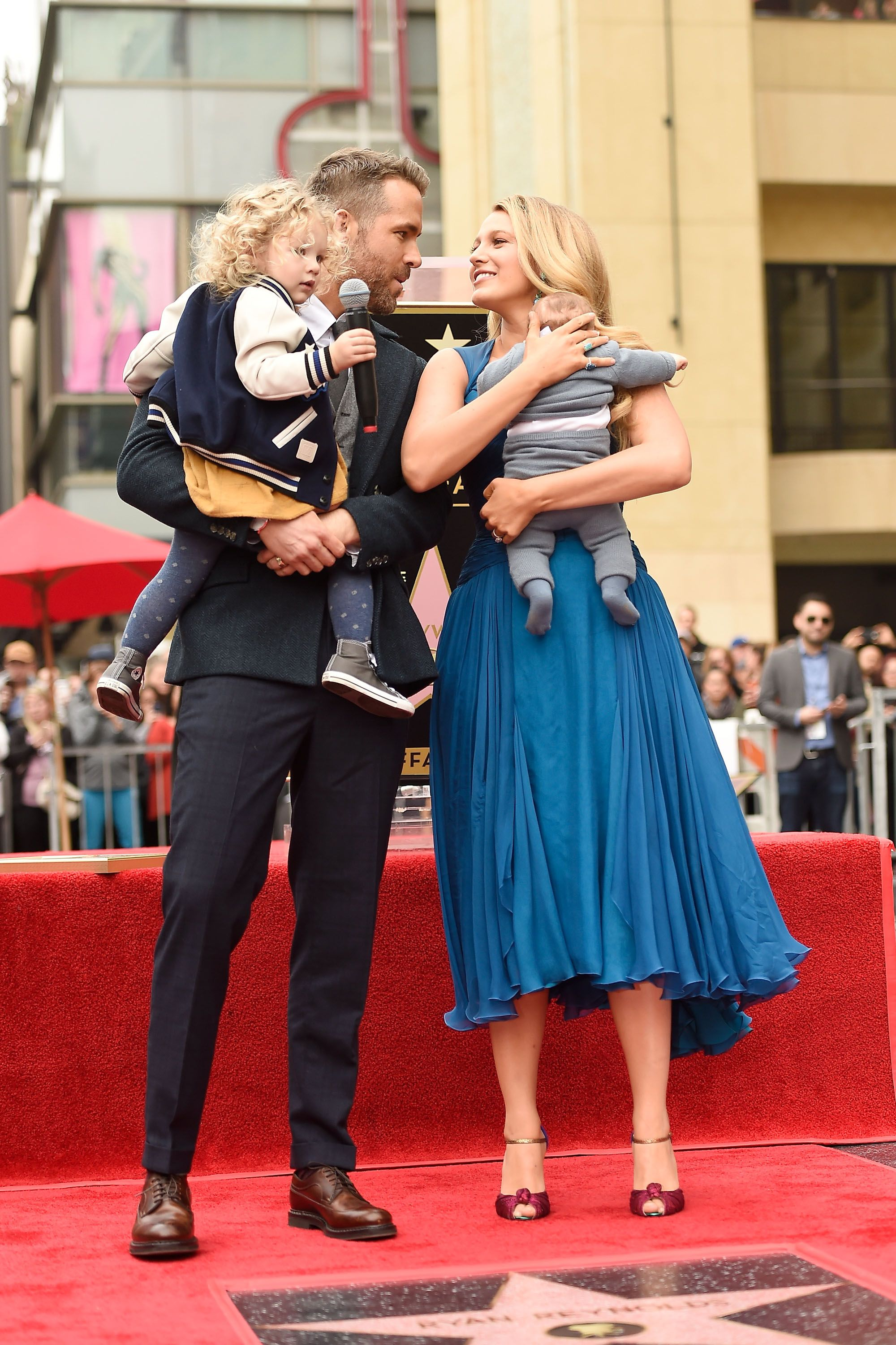 Ryan Reynolds (L) and Blake Lively pose with their daughters as Ryan Reynolds is honored with star on the Hollywood Walk of Fame. | Source: Getty Images