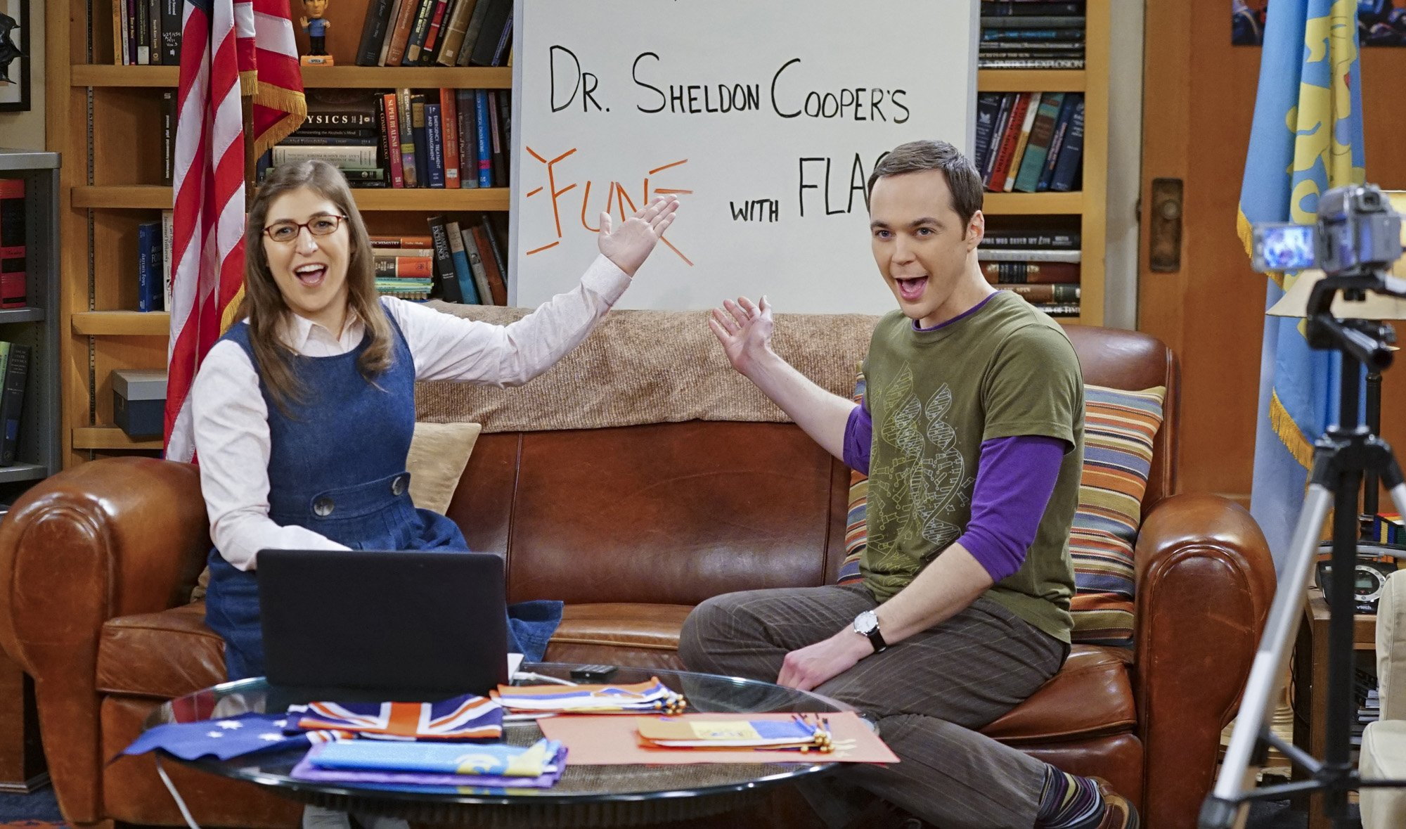 """Sheldon (Jim Parsons, right) and Amy (Mayim Bialik, left) host a live Valentine's Day episode of Fun with Flags on """"The Big Bang Theory."""" 