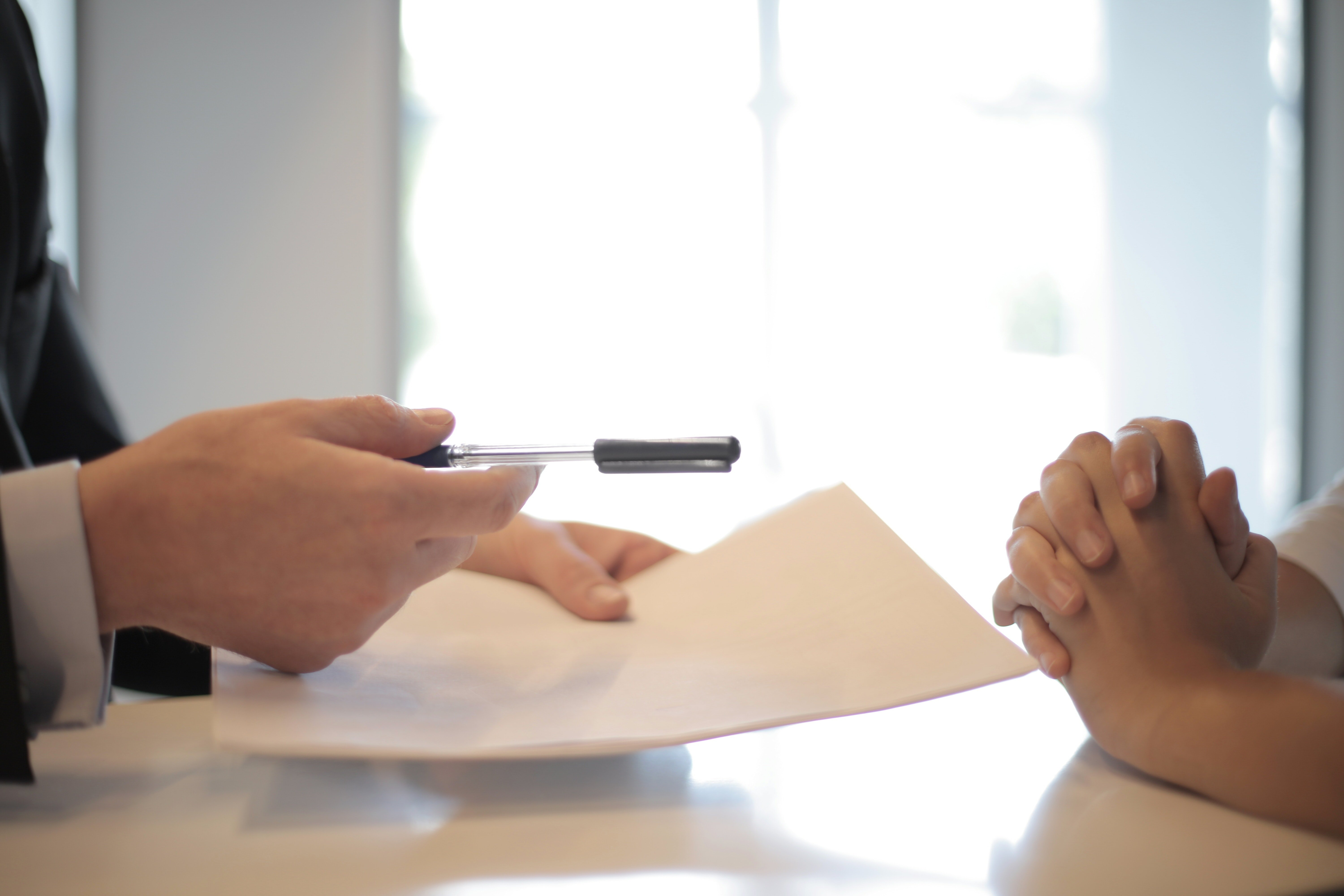 I found a courier on my porch holding some documents for me to sign | Source: Pexels