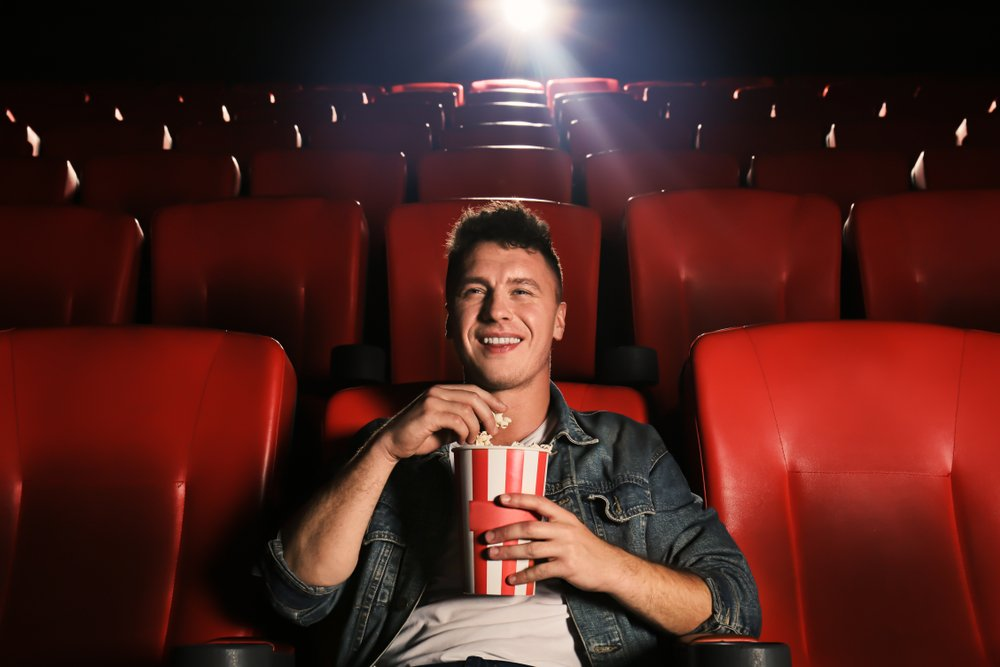 A photo of a young man watching movie in cinema.   Photo: Shutterstock