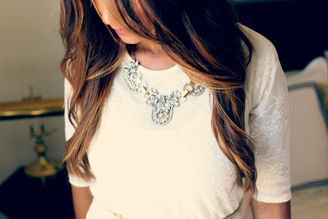 Woman wearing a necklace. Image credit: Pixabay