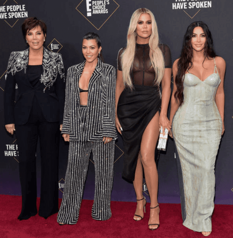 Kris Jenner, Kourtney Kardashian, Khloé Kardashian and Kim Kardashian pose side by side on the red carpet for the 2019 E! People's Choice Awards, on November 10, 2019 in Santa Monica, California | Source: Getty Images (Photo by Rodin Eckenroth/WireImage)