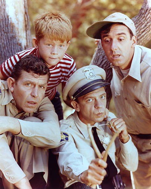 Andy Griffith as Sheriff Andy Taylor, Jim Nabors as Gomer Pyle, Ron Howard as Opie Taylor and Don Knotts as Deputy Barney Fife in 'The Andy Griffith Show', circa 1963 | Photo: GettyImages