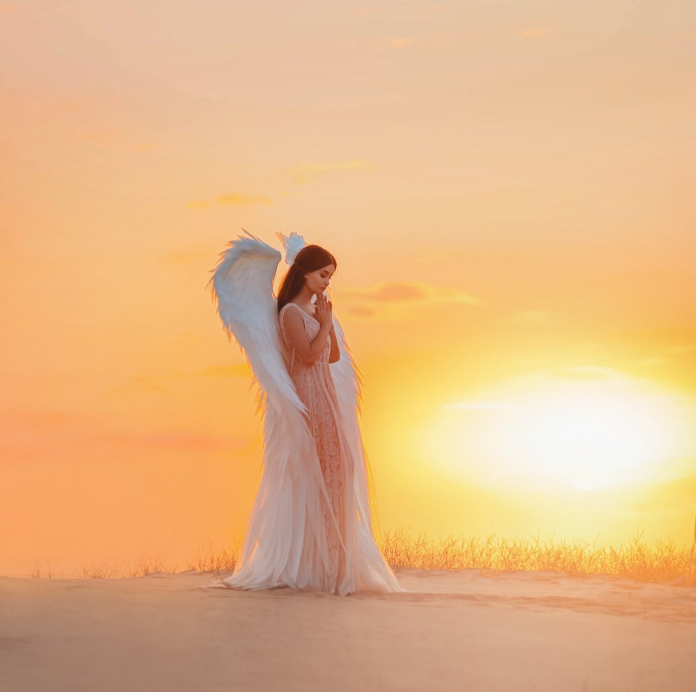 A silhouette of a young woman angel. | Photo: Shutterstock