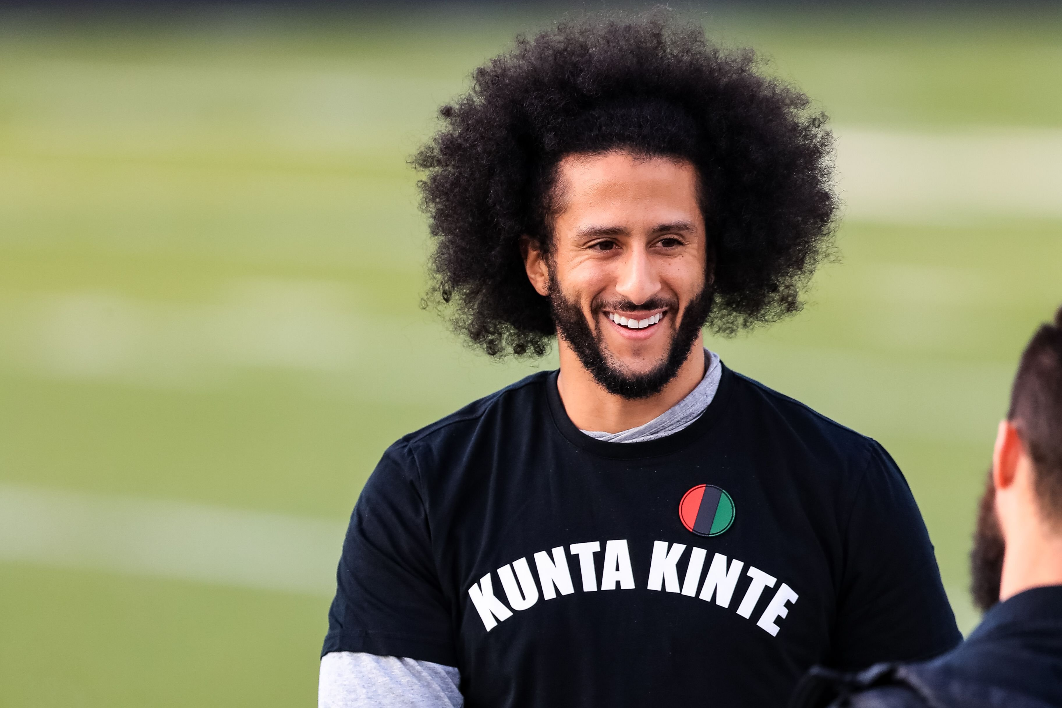 Colin Kaepernick looks on during his NFL workout held at Charles R Drew high school on November 16, 2019 in Riverdale, Georgia. | Source: Getty Images