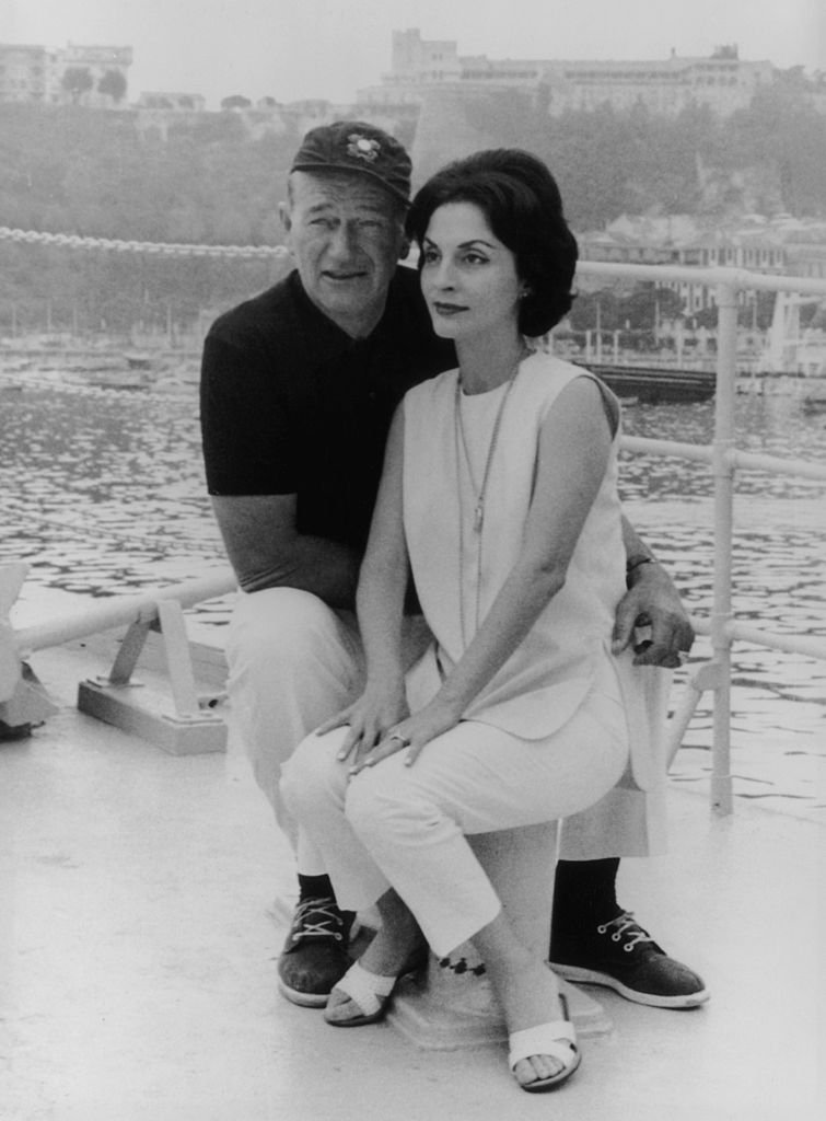 John Wayne and his wife Pilar on board their yacht 'The Wild Goose' at Monte Carlo, on 26th August 1963   Photo: Getty Images