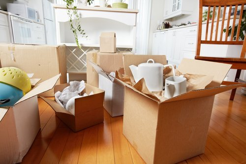Moving boxes packed with belongings. | Source: Shutterstock.