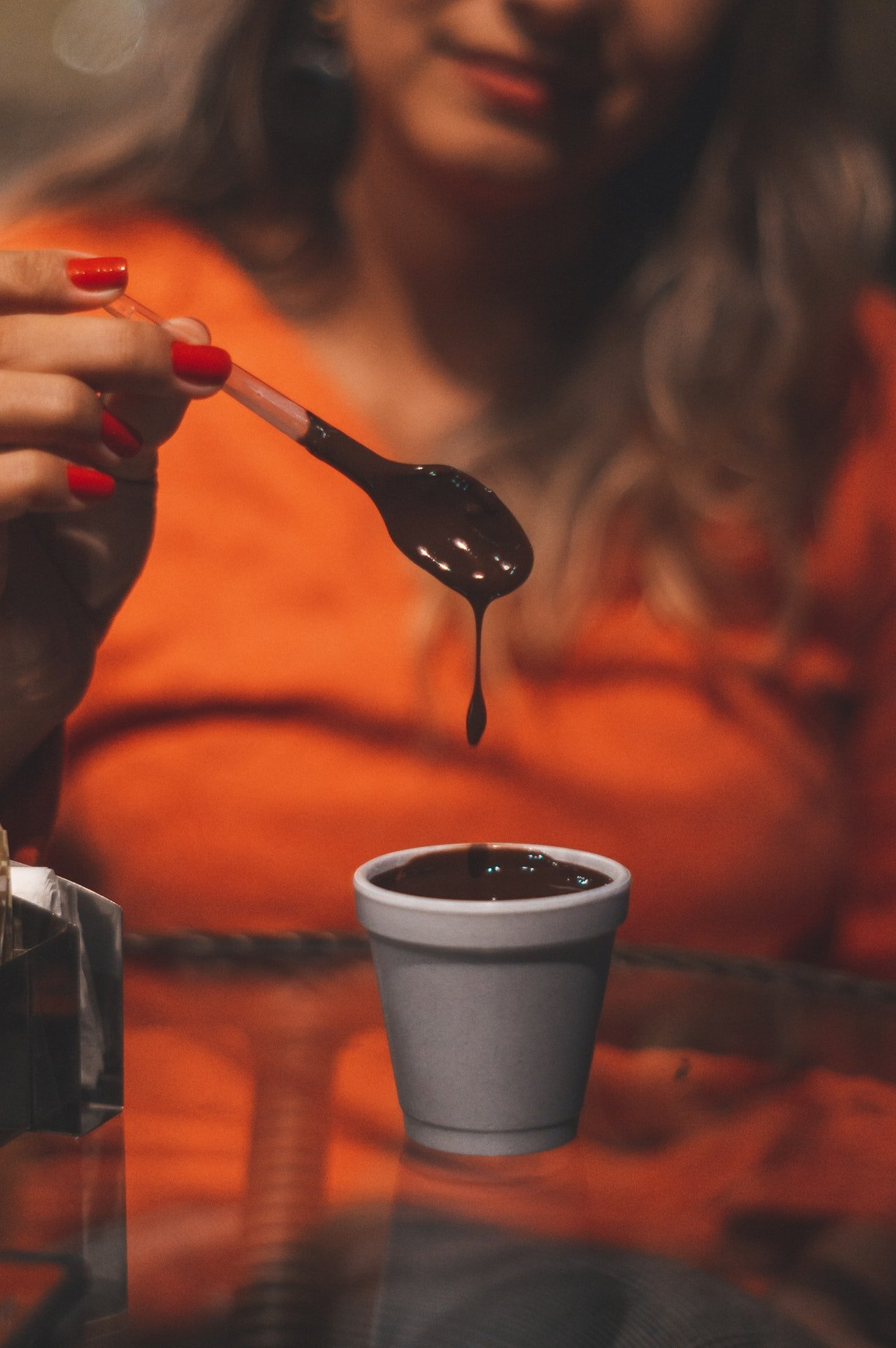 Photo of a woman with a chocolatey drink | Photo: Pexels
