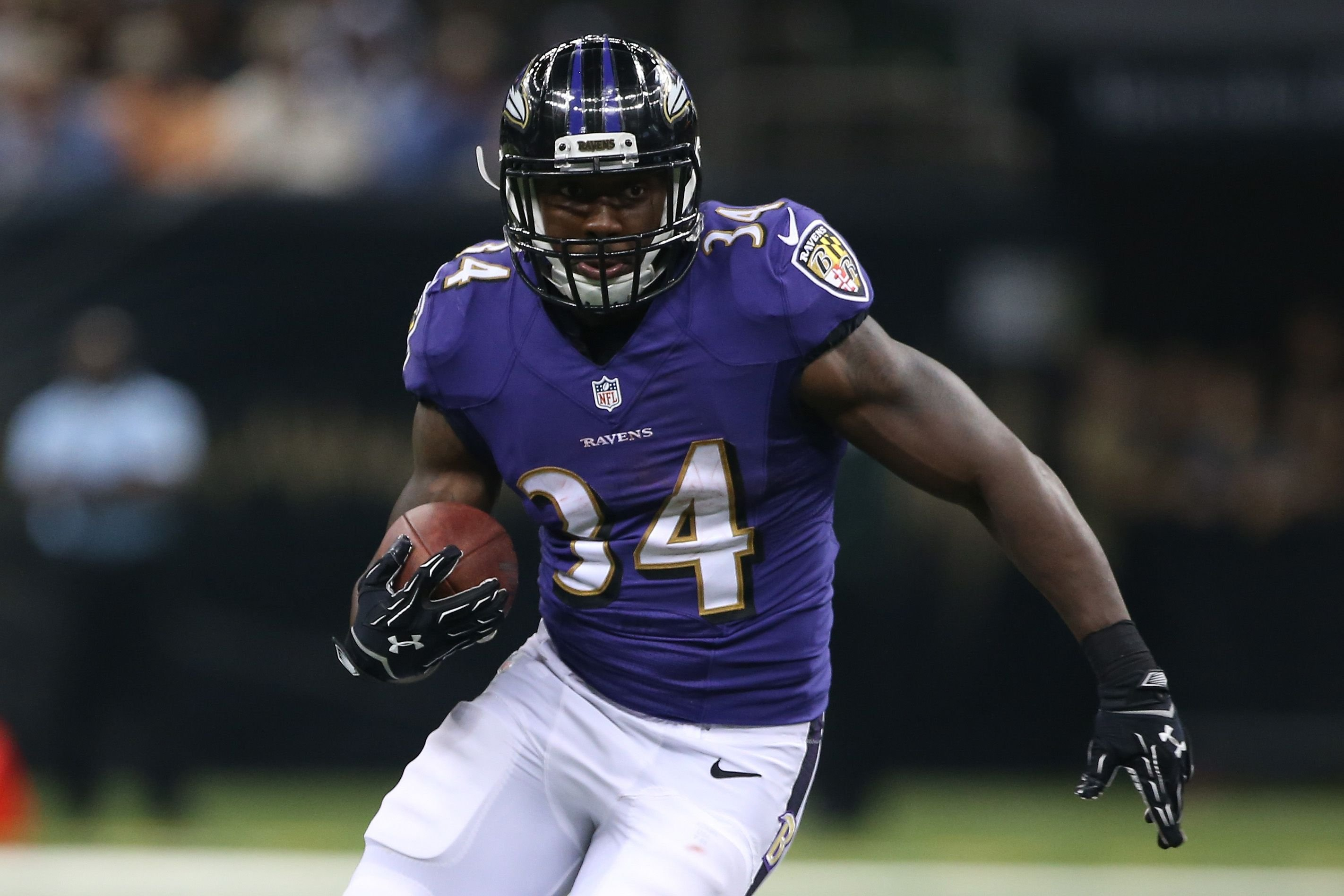 Lorenzo Taliaferro of the Baltimore Ravens playing against the New Orleans Saints on August 28, 2014, in New Orleans, Louisiana | Photo:Chris Graythen/Getty Images
