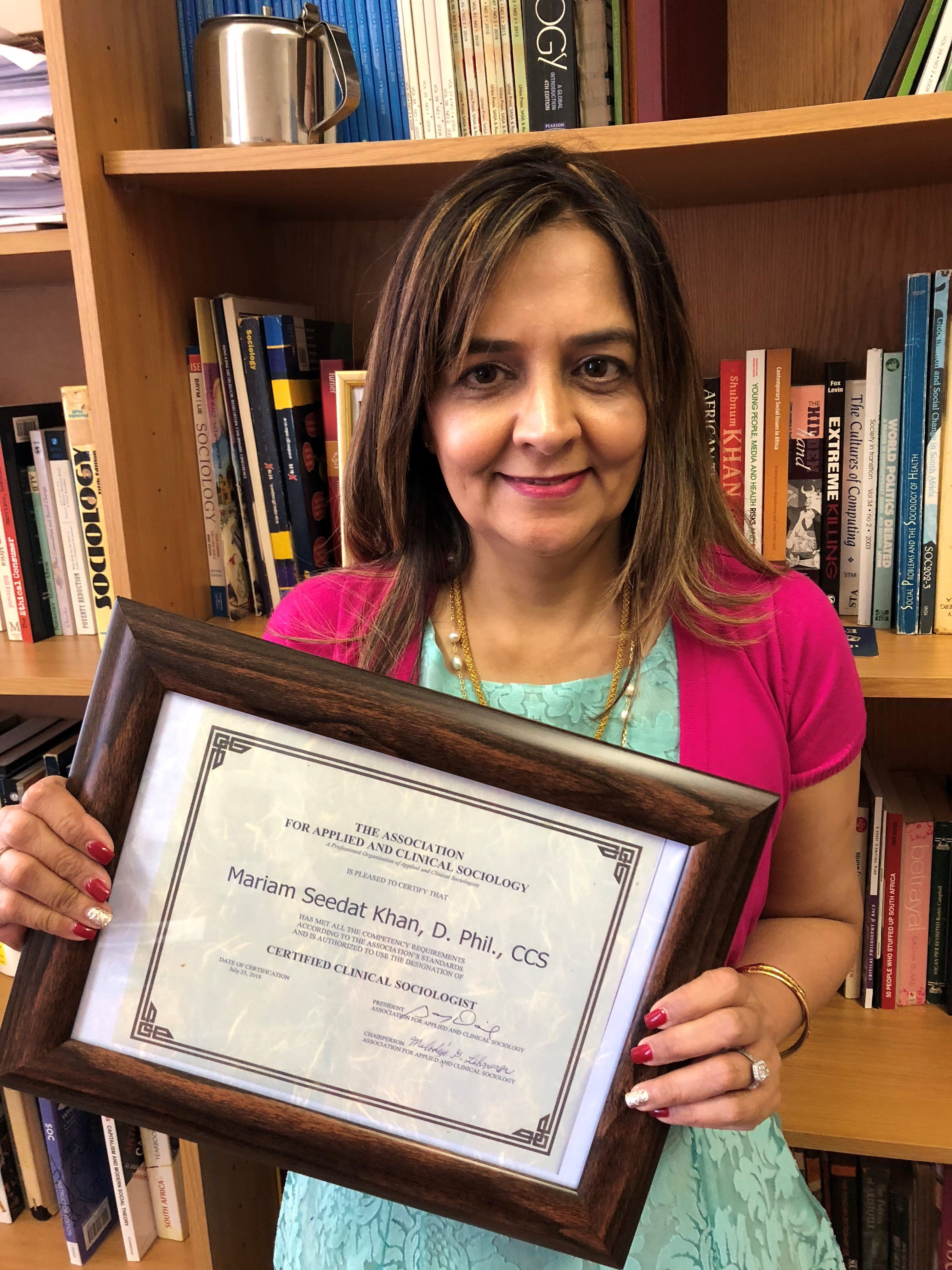 Mariam with her certificate from the Association for Applied and Clinical Sociology (AACS).  Source: Dr. Mariam Seedat Khan