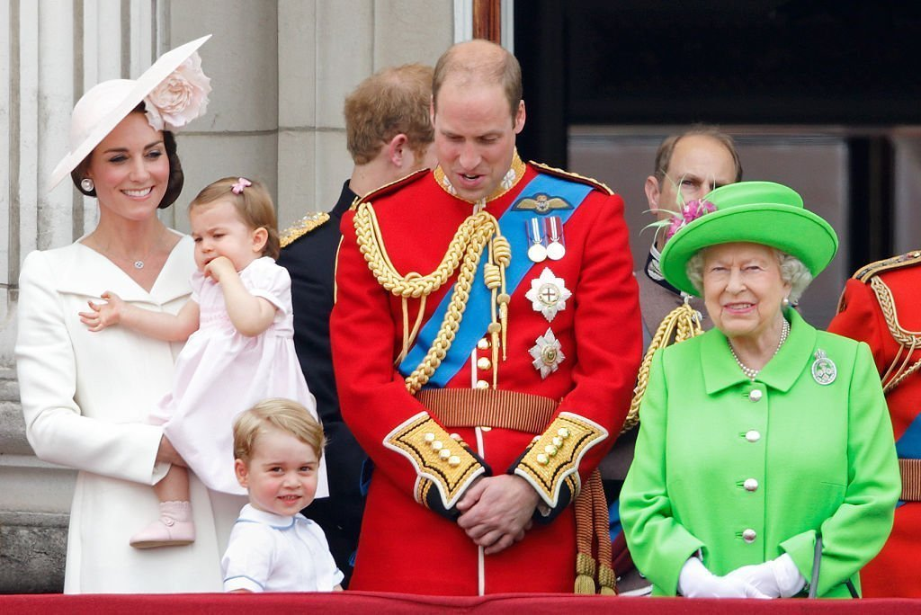 Catherine, Duchess of Cambridge, Princess Charlotte of Cambridge, Prince George of Cambridge, Prince William, Duke of Cambridge and Queen Elizabeth II watch the flypast from the balcony of Buckingham Palace during Trooping the Colour, this year marking the Queen's 90th birthday | Photo: Getty Images