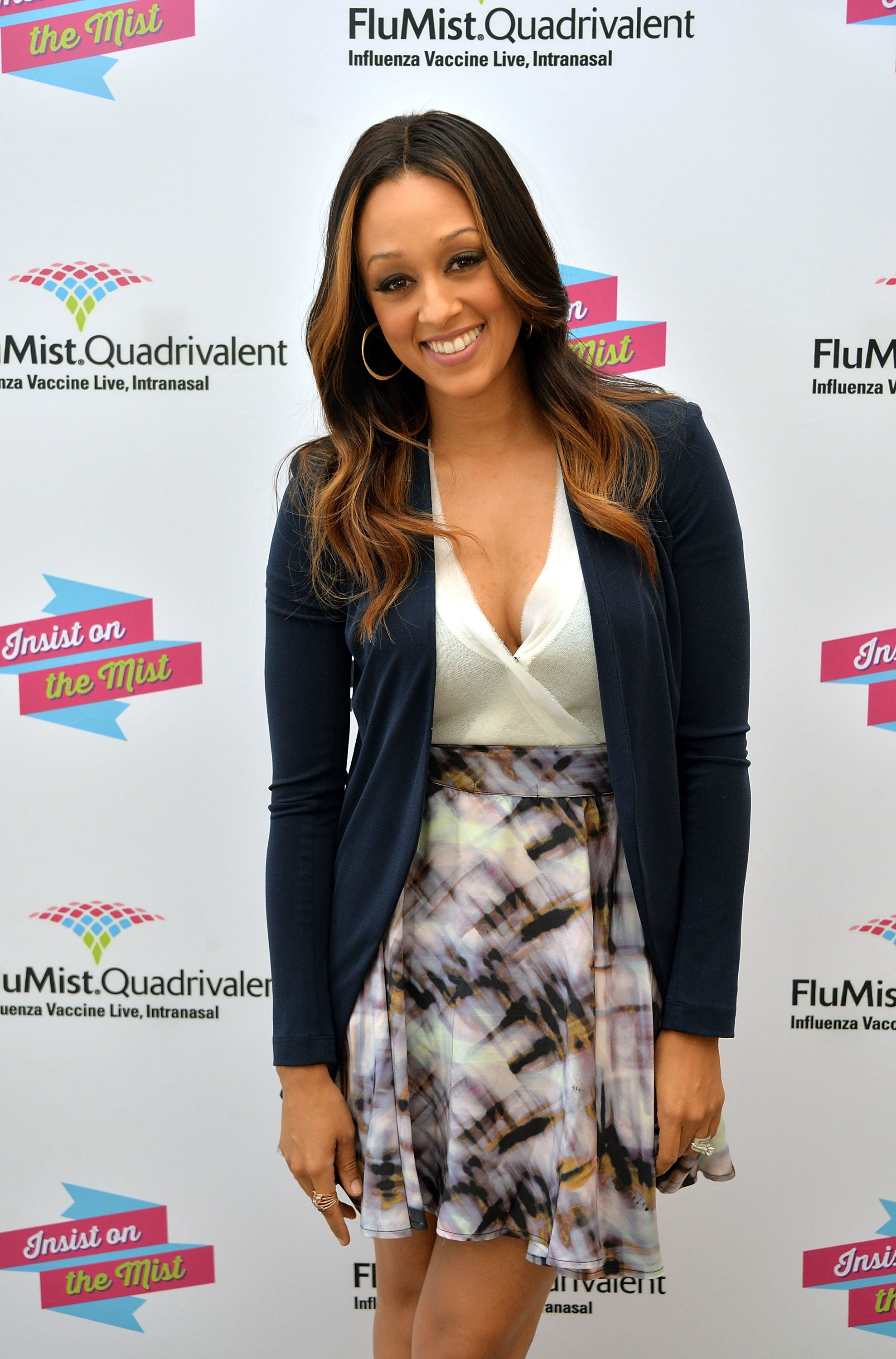 "Actress and mom Tia Mowry at the launch of ""I Insist!""- a FluMist Quadrivalent (Influenza Vaccine Live, Intranasal) video in which she starred on September 23, 2013 