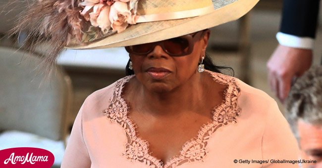 Oprah Winfrey arrives at Prince Harry & Meghan Markle's Royal wedding in a light pink dress
