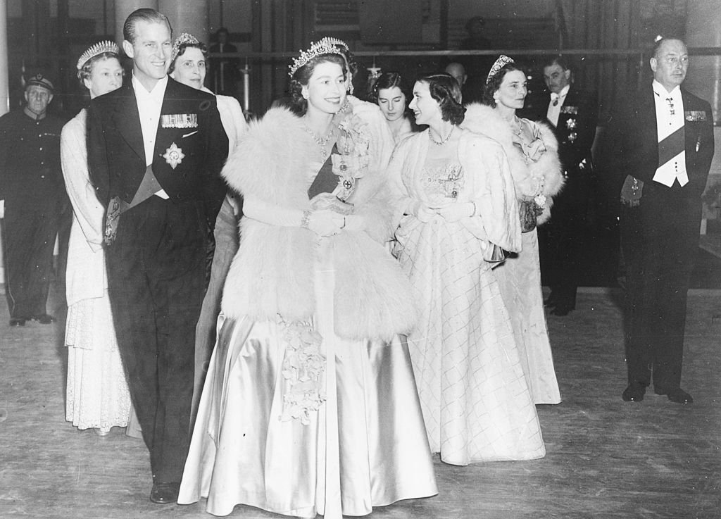 HM Queen Elizabeth II and Prince Philip, the Duke of Edinburgh, wearing formal dress as they attend a concert at Festival Hall. | Source: Getty Images