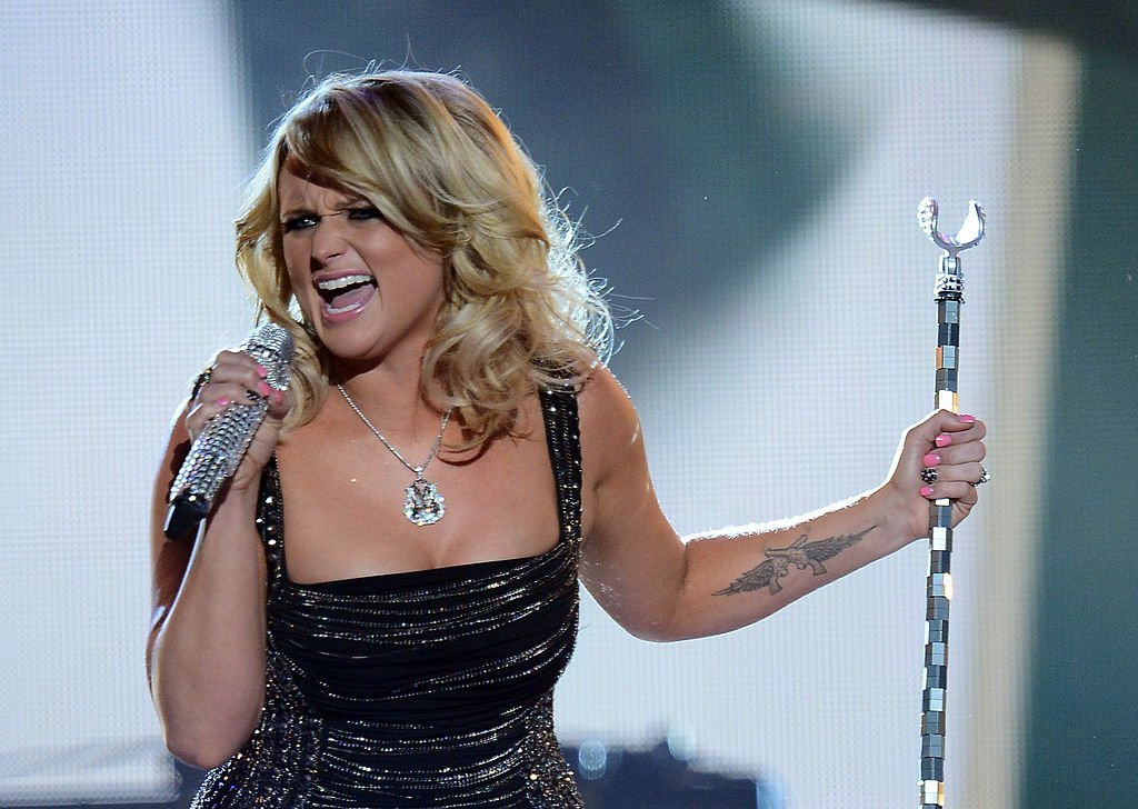 Miranda Lambert displays her guns tattoo as she performs at the 48th Annual Academy of Country Music Awards in Las Vegas, Nevada on April 7, 2013 | Photo: Getty Images
