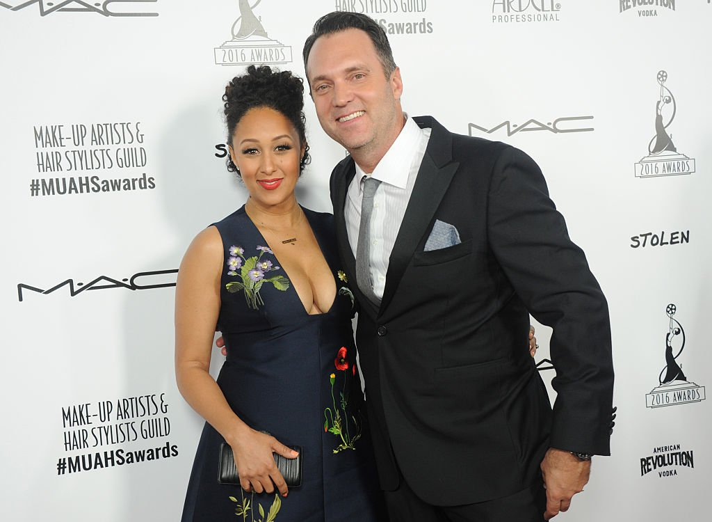 Actress and TV host Tamera Mowry- Housley and husband Adam Housley attend the 2016 Make-up Artist and Hairstylist Guild Awards in Hollywood, California. | Photo: Getty Images