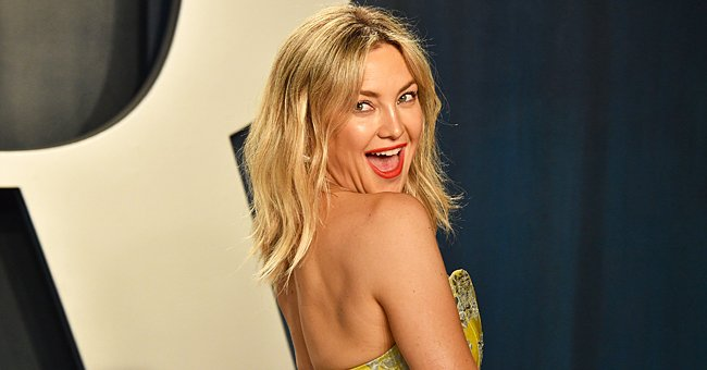 Kate Hudson Shows off Toned Belly and Her Perfect Pout in a Bright Pink Workout Set