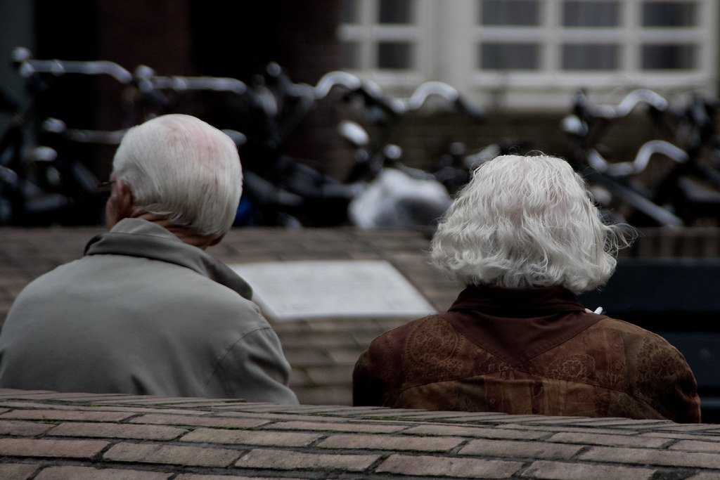 Old couple seating together | Photo: Flickr