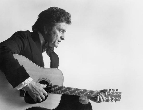 Johnny Cash playing an acoustic guitar, in a promotional still for the 11th annual Country Music Association Awards | Photo: Getty Images