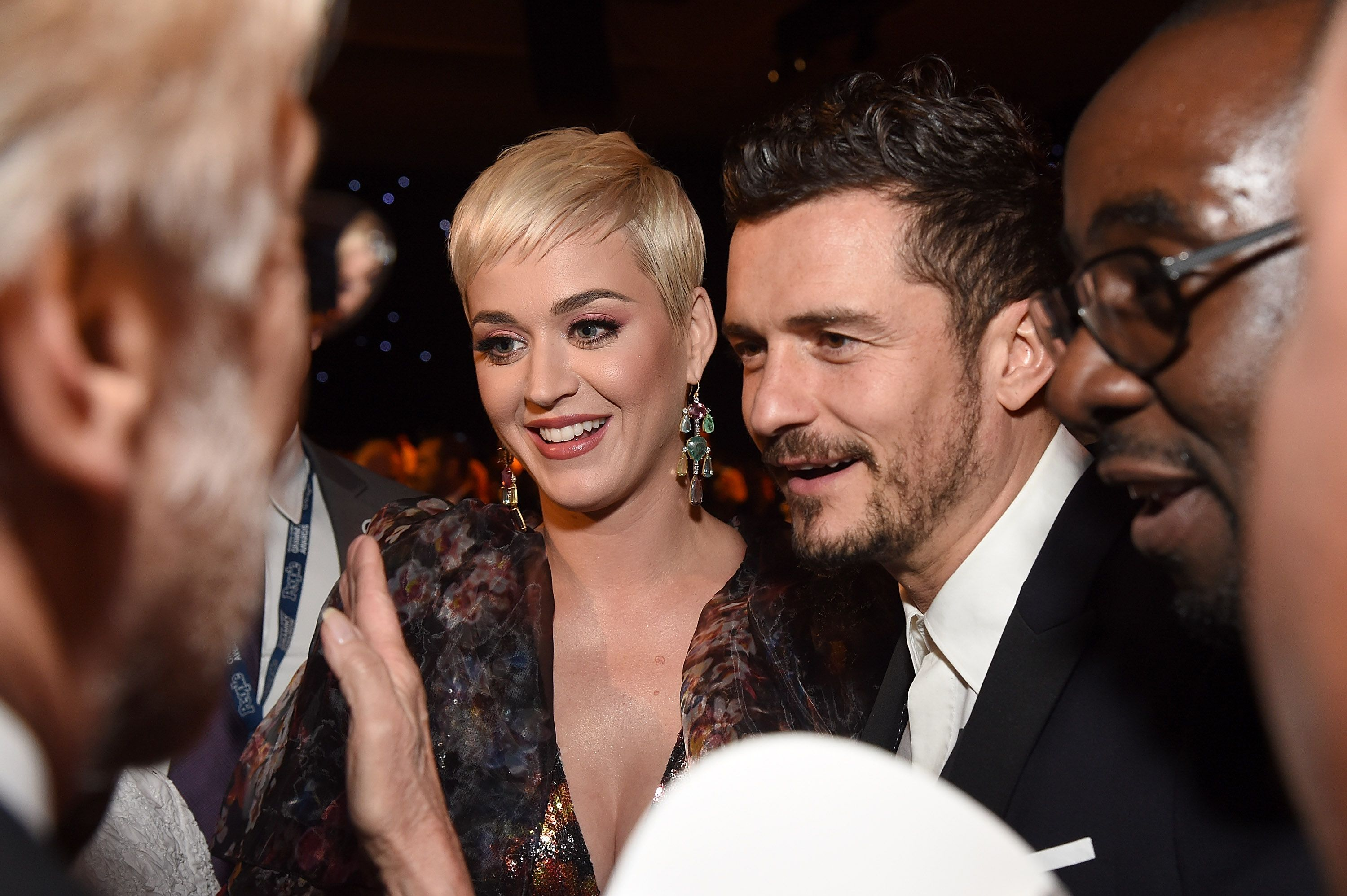 Katy Perry (L) and Orlando Bloom attend MusiCares Person of the Year honoring Dolly Parton at Los Angeles Convention Center on February 8, 2019 in Los Angeles, California. | Source: Getty Images