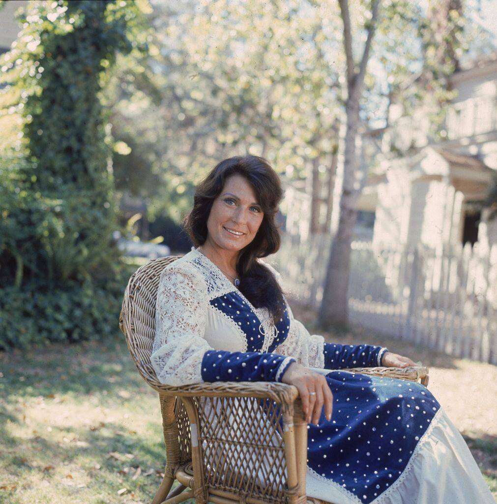 Loretta Lynn as she sits outside in a chair, 1970s.   Source: Getty Images