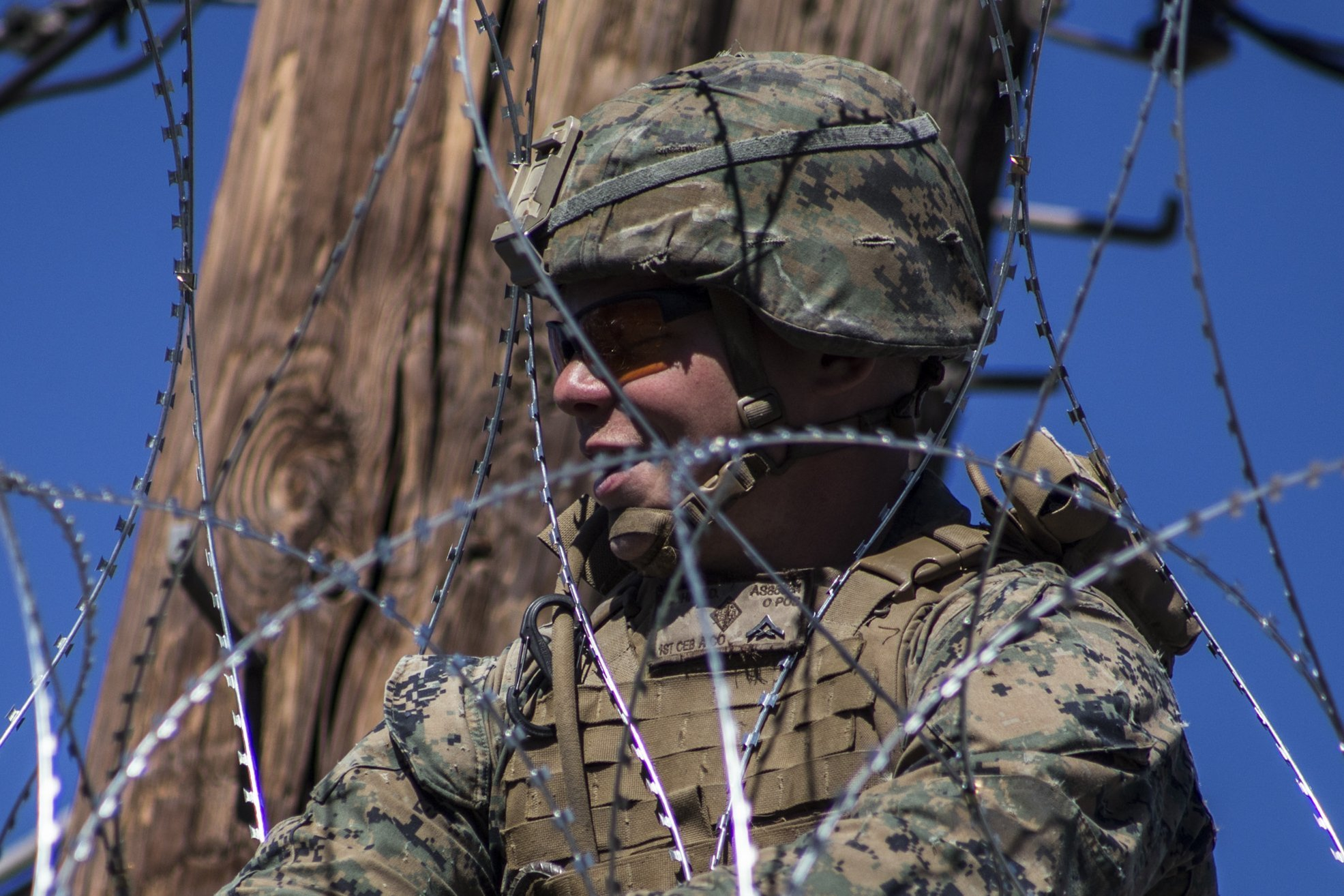 An Army soldier seen from the Mexican side of the U.S.-Mexico border wall in Mexicali, Mexico   Photo: Getty Images